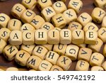 achieve word written on wood... | Shutterstock . vector #549742192