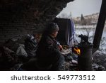 syrian refugee heating with... | Shutterstock . vector #549773512