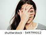 girl laughs and covers her mouth | Shutterstock . vector #549799312