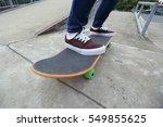 young skateboarder legs riding... | Shutterstock . vector #549855625