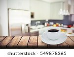 wooden table against a cup of... | Shutterstock . vector #549878365