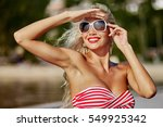 Happy Woman In Bikini Posing O...