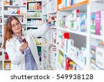 Woman Pharmacist Holding...