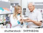 helpful pharmacist. cheerful... | Shutterstock . vector #549948346