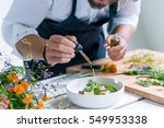 chef cooks meal | Shutterstock . vector #549953338