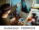 Male Artist Working On Paintin...