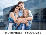 portrait of happy young family... | Shutterstock . vector #550047256