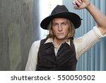 vintage 1900 cowboy. young man. | Shutterstock . vector #550050502