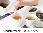 woman poured hot green tea into ... | Shutterstock . vector #550070992
