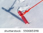 red tent peg hammered in a snow ... | Shutterstock . vector #550085398