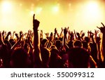 silhouettes of concert crowd in ... | Shutterstock . vector #550099312