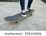 young skateboarder legs riding...   Shutterstock . vector #550124956