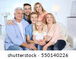 happy family gathered in living ... | Shutterstock . vector #550140226