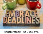 Small photo of embrace deadlines - word abstract in vintage letterpress wood type blocks with cups of coffee