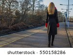 Woman Stands On The Platform...