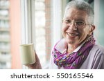 Old Senior Woman Drinking A...