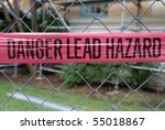 Small photo of Lead abatement warning sign in front of an old building undergoing renovations