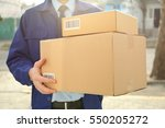 courier with parcel in doorway  ... | Shutterstock . vector #550205272
