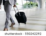 businessmen hold luggage... | Shutterstock . vector #550242292