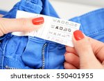 woman checking the care label... | Shutterstock . vector #550401955