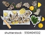 oysters on crushed ice with... | Shutterstock . vector #550404532