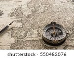 compass and ink pen on vintage ... | Shutterstock . vector #550482076