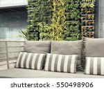 Stock photo beautiful vertical garden with outdoor sofa for family relaxing zone 550498906