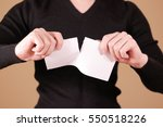 Small photo of Man tearing a piece of paper in half blank white flyer brochure booklet. Leaflet presentation. Pamphlet hold hands. Male show clear offset paper. Sheet template. Booklet design sheet display