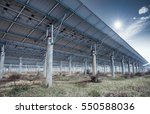 solar panels against a blue sky ... | Shutterstock . vector #550588036