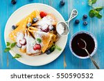 crepes with jam  berries and... | Shutterstock . vector #550590532