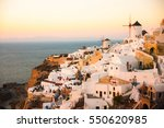 cityscape of oia at sunset ... | Shutterstock . vector #550620985
