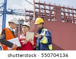 workers discussing in shipping... | Shutterstock . vector #550704136