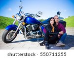 young couple sitting on road... | Shutterstock . vector #550711255