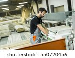 handsome young man working in... | Shutterstock . vector #550720456