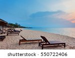Wooden Chairs On Beach In...