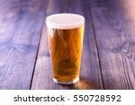 small pint of lager on a wooden ... | Shutterstock . vector #550728592