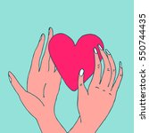 hands holding red heart hand... | Shutterstock .eps vector #550744435