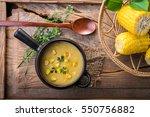 corn soup in bowl on wooden | Shutterstock . vector #550756882