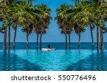 a man relaxing in an infinity...   Shutterstock . vector #550776496