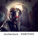 Small photo of Serial maniac in hockey mask at torture chamber