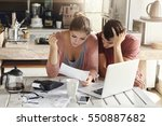 young couple doing paperwork in ... | Shutterstock . vector #550887682