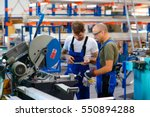 two worker in factory on the... | Shutterstock . vector #550894288