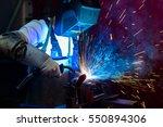 man welding metal in the factory | Shutterstock . vector #550894306