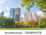 manhattan buildings in foliage... | Shutterstock . vector #550894378