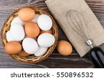 White And Brown Eggs In Wicker...