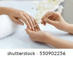 cuticle remover. closeup of... | Shutterstock . vector #550902256