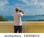 Man Take Picture Sea View On...