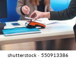 man using mobile phone to pay | Shutterstock . vector #550913386