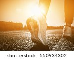 young athlete in sneakers makes ... | Shutterstock . vector #550934302