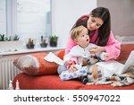 baby boy taking tissue from box.... | Shutterstock . vector #550947022